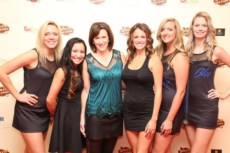 Beth on red carpet with cigar girls